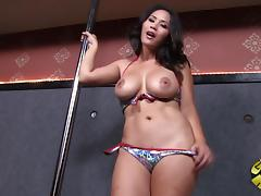 Randy brunette on the stripper pole showing off her big tits