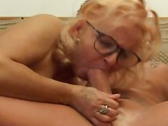 Horny granny fucks hot young tattooed dude with big cock