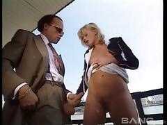 Redhead on a boat strips to her stockings for deep anal sex