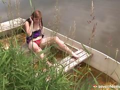 Hot lady masturbates on a boat in naked