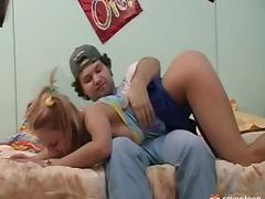 Flirty teen in a short skirt is a great fuck in his bedroom