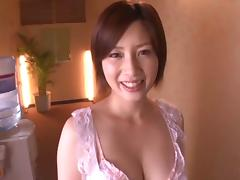 Bikini clad Japanese milf gives her stud an arousing blowjob then gets fucked