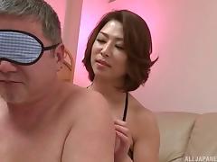 Facesitting Asian babe in a smoking hot black fishnet body stocking