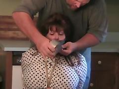 Elane bound in the kitchen (big blindfold).