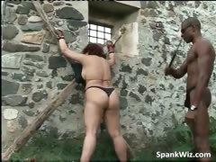 Tied redhead slut gets butt spanked