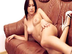 Hot brunette beauty teasing on couch