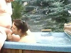Getting hot and bothered in a hot tub the brunette sex goddess acts like his genie All he has to do