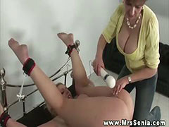Busty mature stimulating subs clit manually