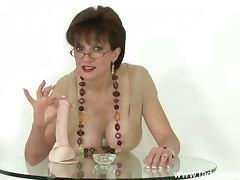 Glasses milf teaches handjob