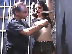 Ball gag in her mouth as he plays with