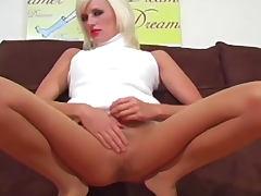 Sleeveless turtleneck is sexy on tease girl