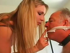 Old fart is sucking rubber cock of his cute lady