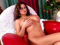 Curly redhead babe Jenny McClain lifts her boobies