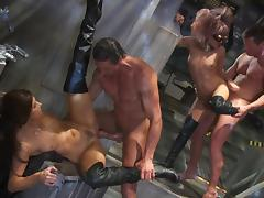 Nasty girls in leather lingerie have sex with guys in suits